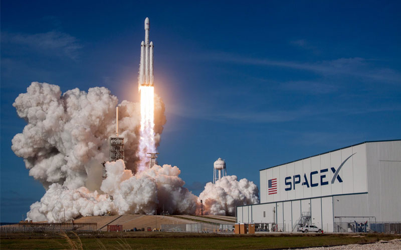 SpaceX Launch the Falcon Heavy with Elon Musk's Tesla Roadster piloted by Starman the test dummy.