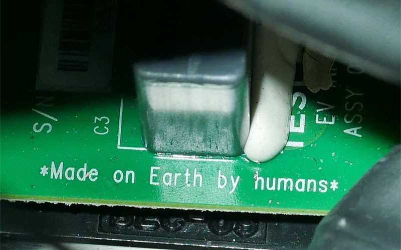 "Printed on a circuit board within the Tesla's electronics is a line that reads, ""Made on Earth by Humans""."
