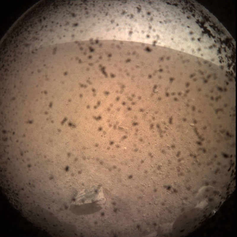 The first image captured by NASA's InSight lander shortly after it touched down on the surface of the Red Planet.