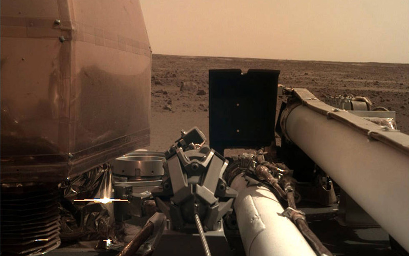 NASA's Insight lander has begun to beam back its first images of the Martian surface.