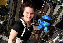 ISS crew member and plush toy, Earth continues work aboard the station.
