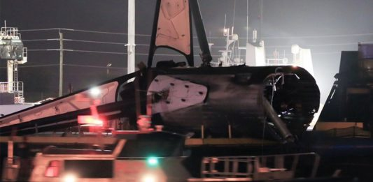 The wreckage of Falcon Heavy core booster B1055 returns to port.