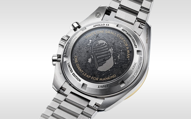 The rear of the commemorative Moon mission Speedmaster features Armstrong's footprint and his famous words.