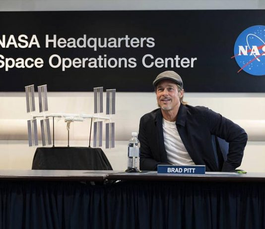 Brad Pitt speaks to NASA astronaut Nick Hague who is stationed aboard the International Space Station.