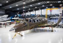 Virgin Galactic reaches a major milestone in the construction of a second SpaceShipTwo vehicle.