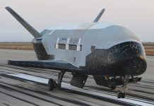 A US Air Force X-37B being prepared for launch will be the first to use a service module.