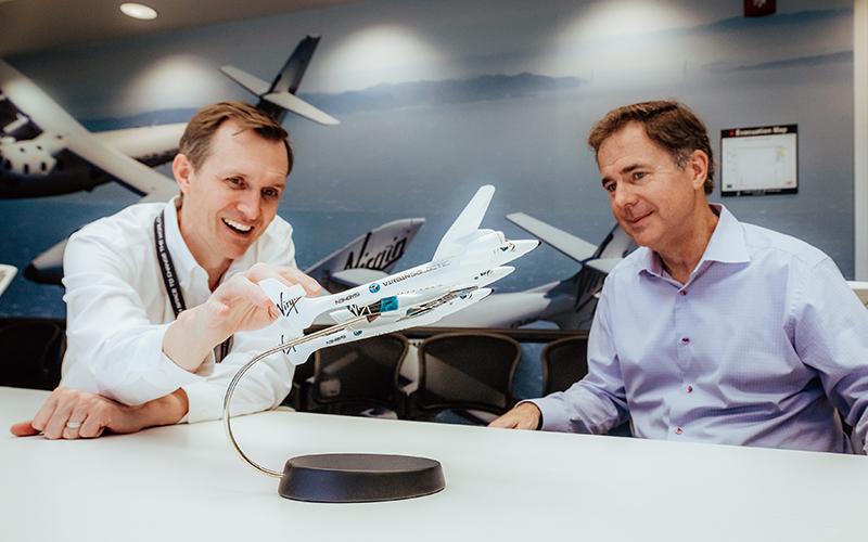 Virgin Galactic names former Disney executive Michael Colglazier as new CEO.
